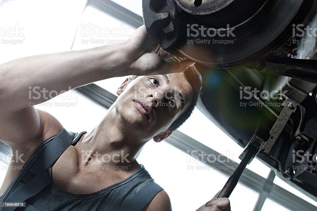 Mechanic repairing car royalty-free stock photo