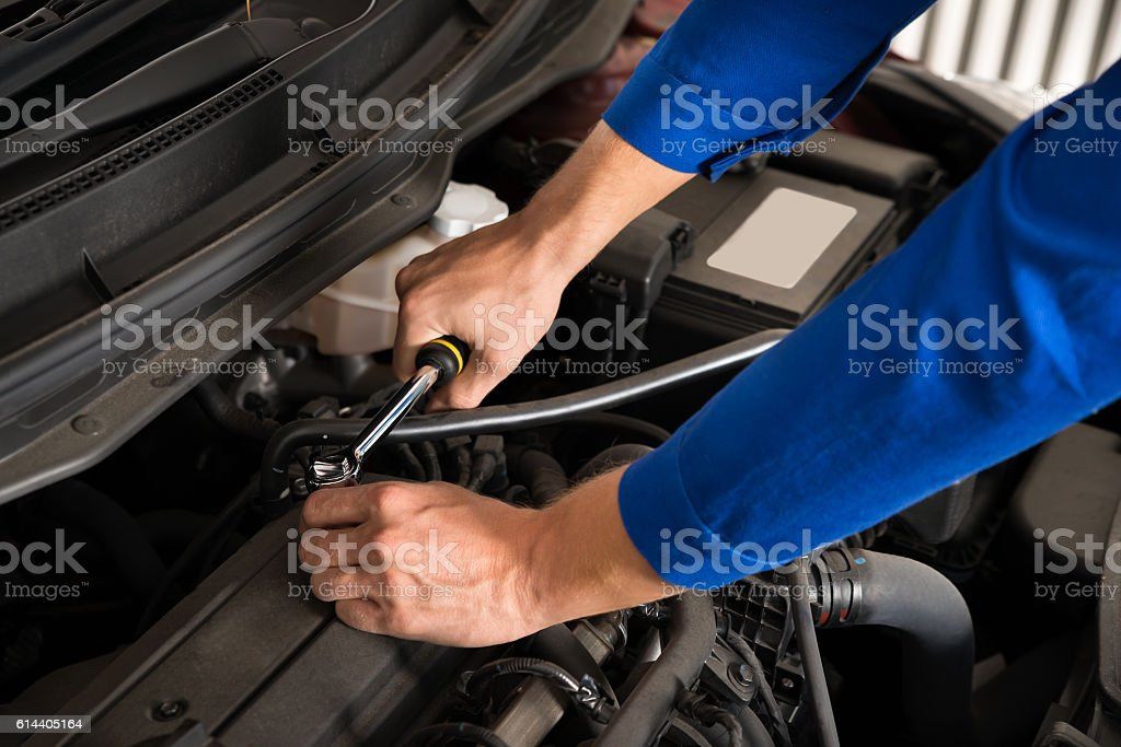 Mechanic Repairing Car stock photo