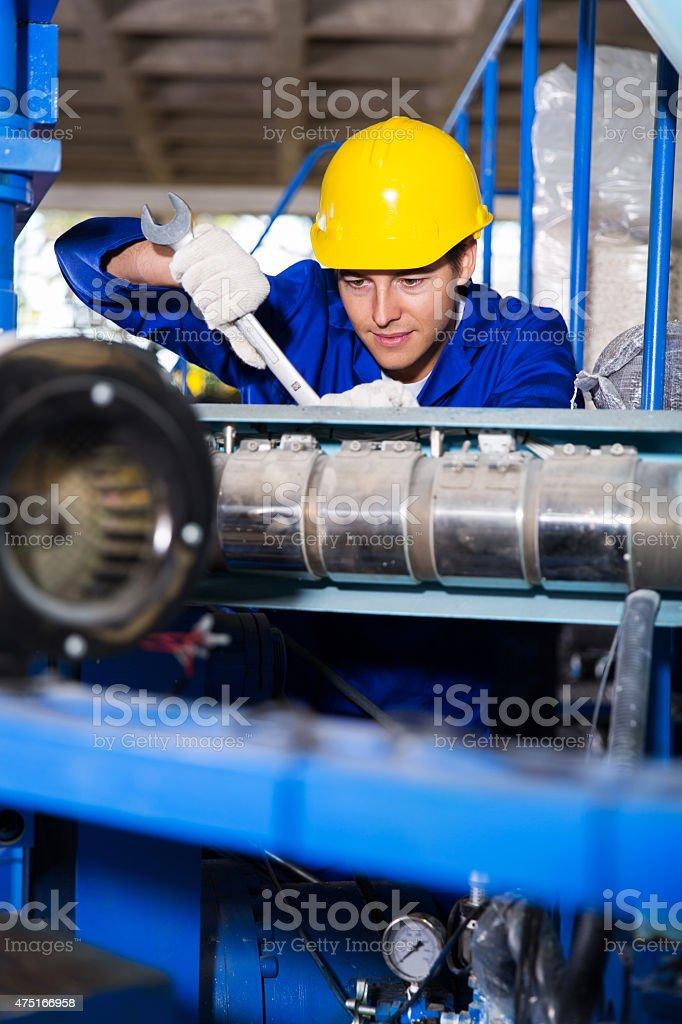 mechanic repairing machine with spanner stock photo
