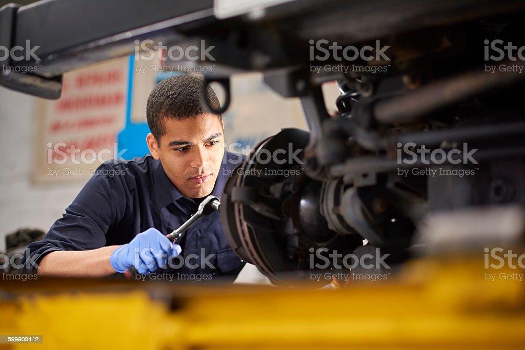 Mechanic repairs stock photo