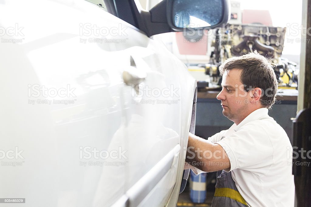 Mechanic servicing a car royalty-free stock photo