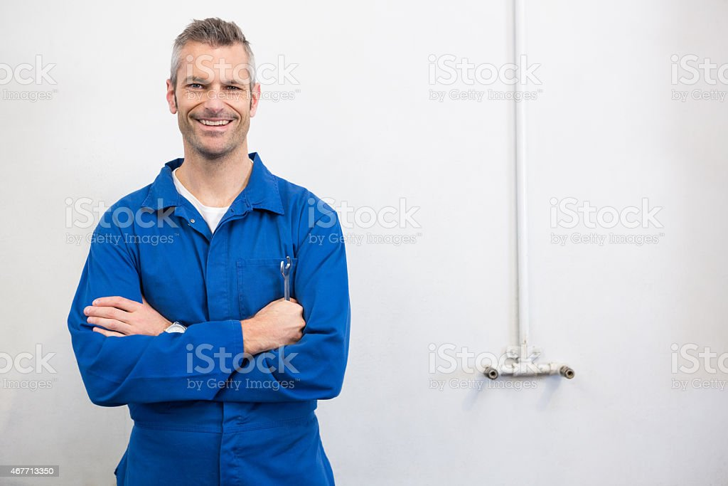 Mechanic smiling at the camera stock photo