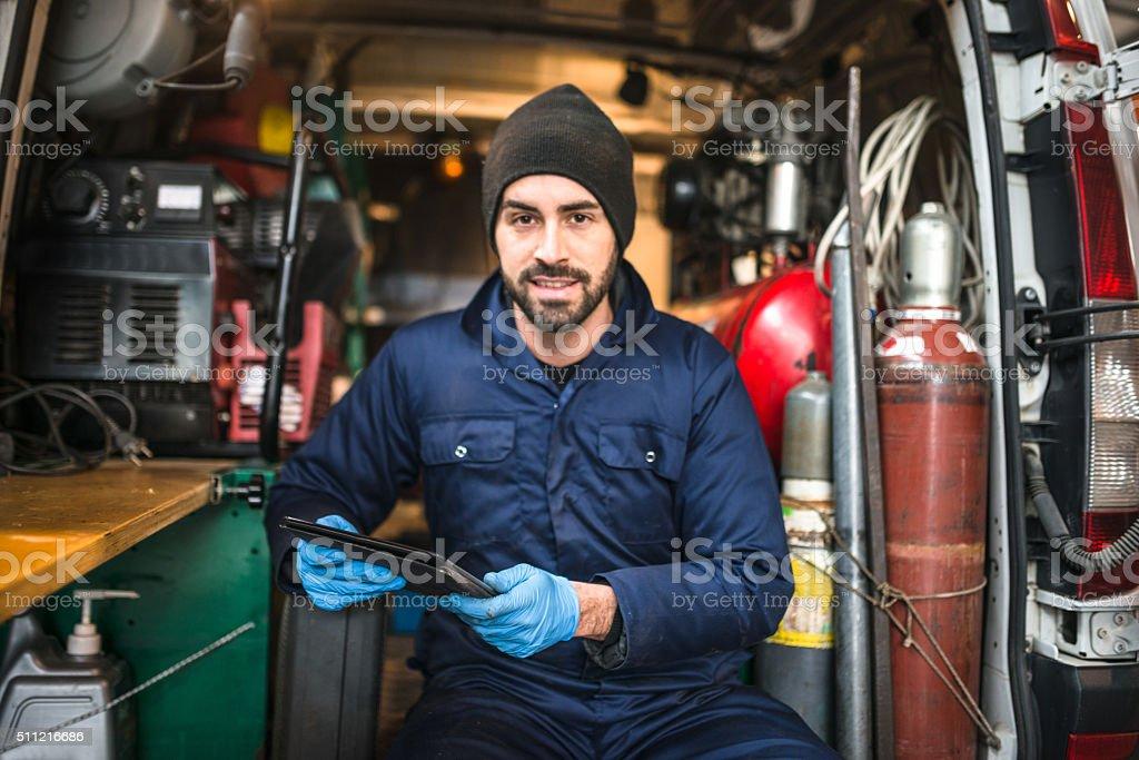 mechanic technician on a garage stock photo