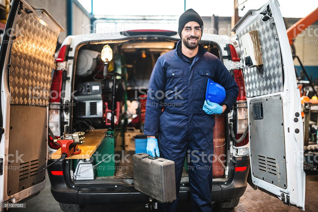 mechanic technician on a garage stock photo