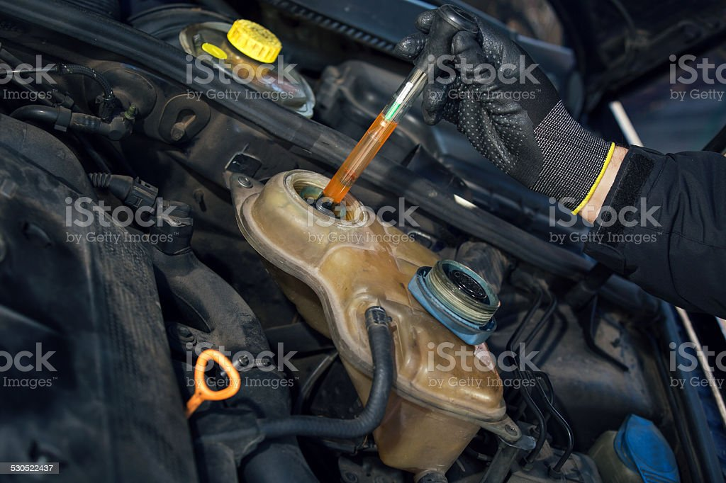 Mechanic Testing Vehicle Radiator Antifreeze Protection Level stock photo