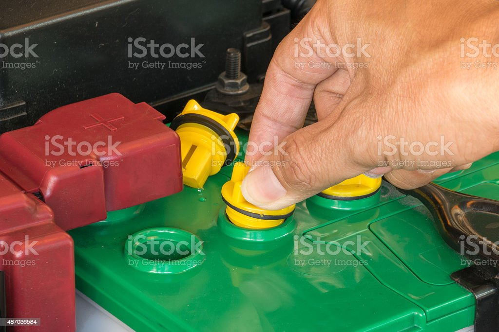 mechanic the battery of a car stock photo