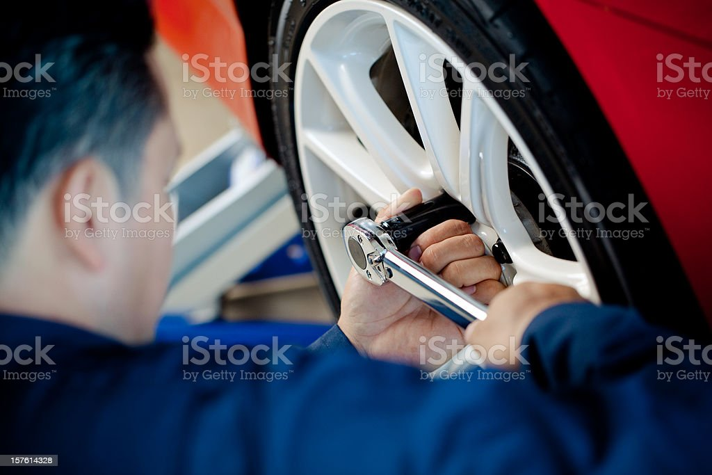mechanic tightening lugnut royalty-free stock photo