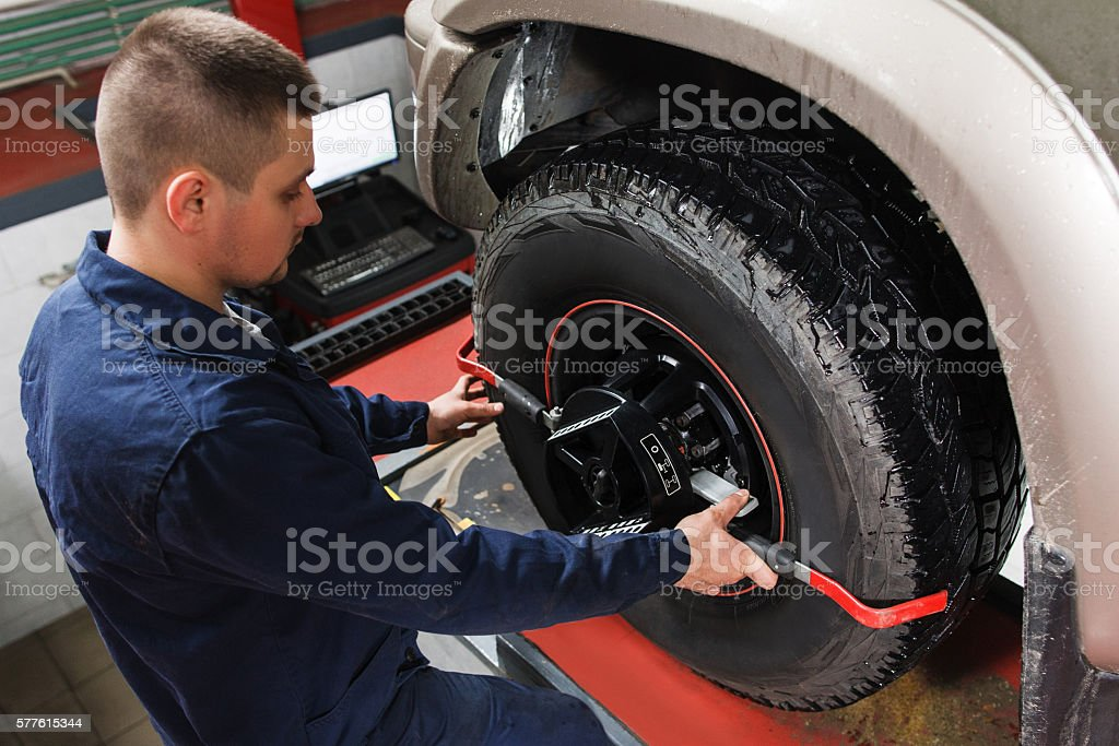 Mechanic tuning aligner for wheel alignment stock photo
