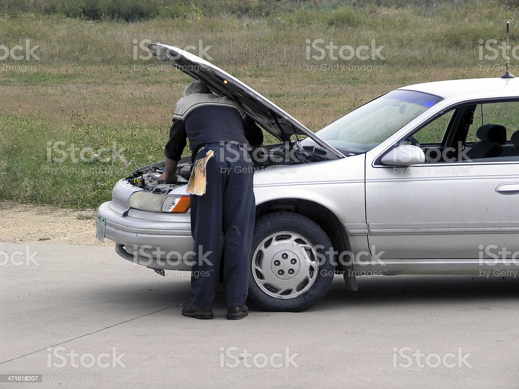 Mechanic Under the Hood royalty-free stock photo