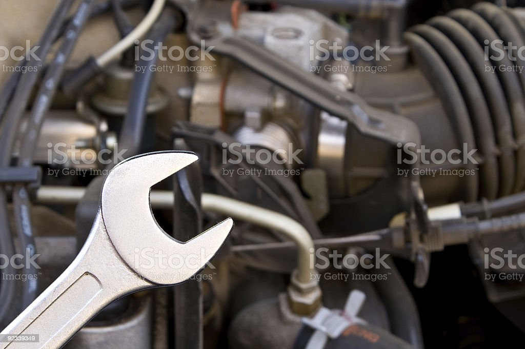 Mechanic using a wrench to fix something stock photo