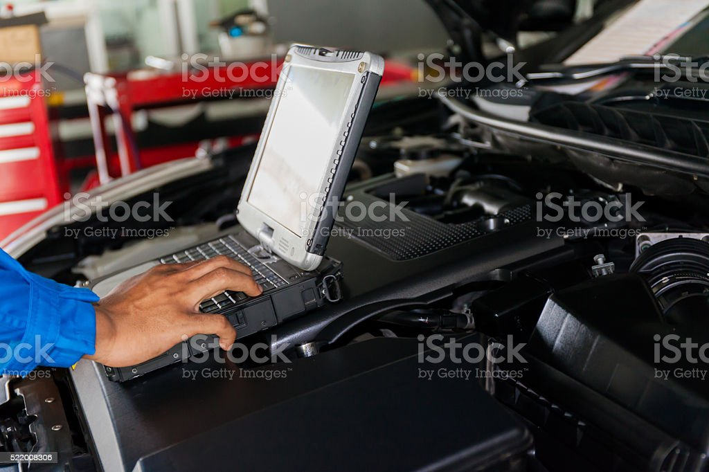 Mechanic using Diagnostic machine tools for car stock photo