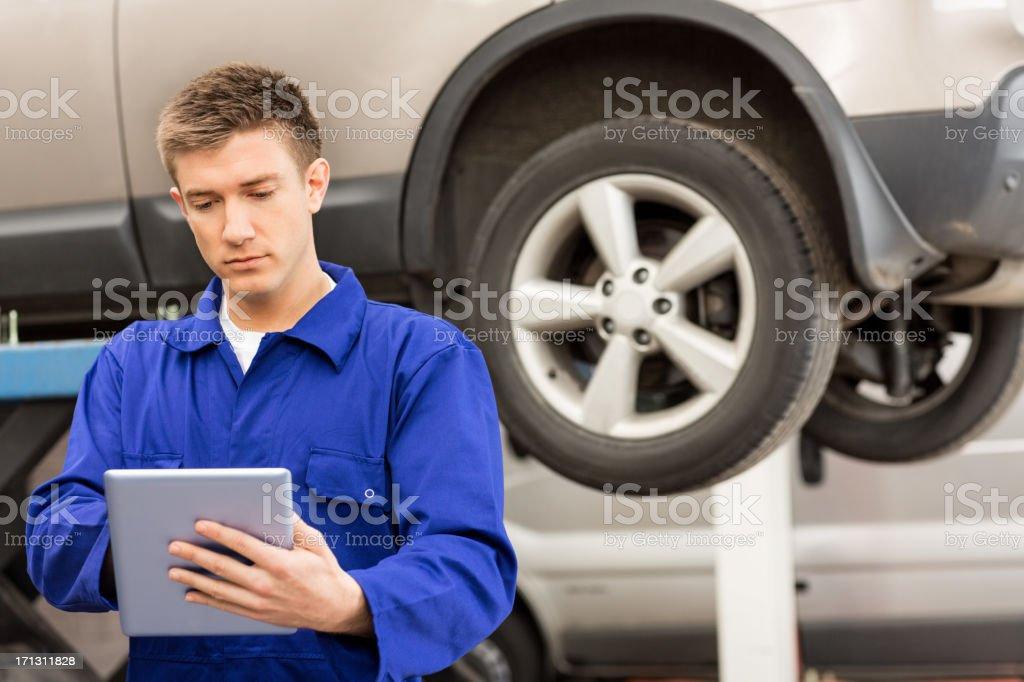 Mechanic Using Digital Tablet royalty-free stock photo