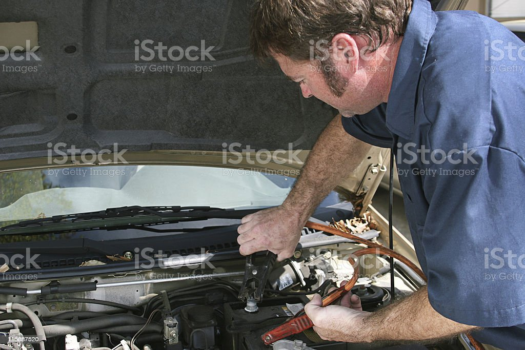 Mechanic Using Jumper Cables stock photo