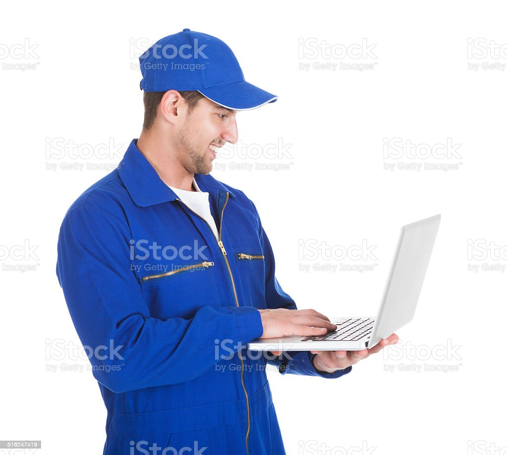 Mechanic Using Laptop Over White Background stock photo