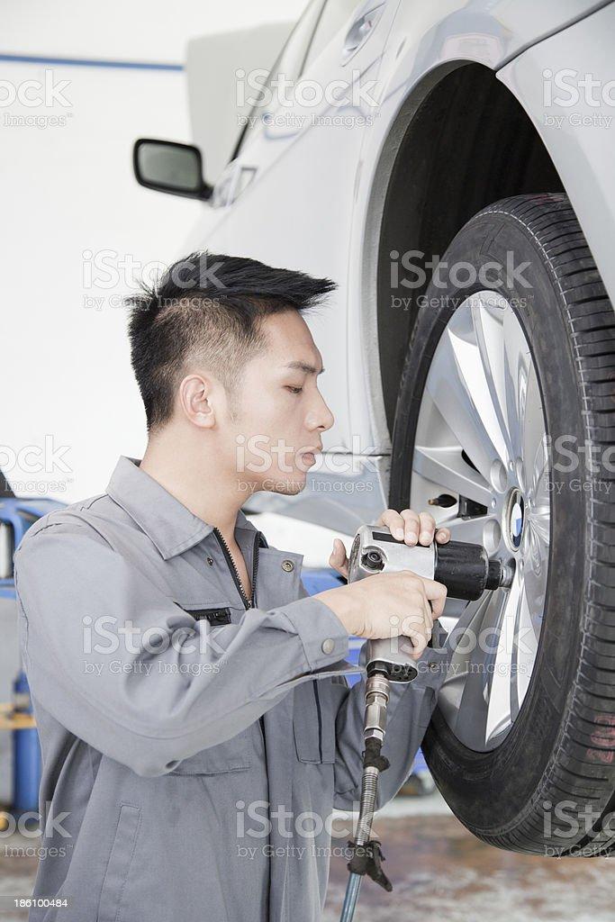 Mechanic Using Power Tool royalty-free stock photo