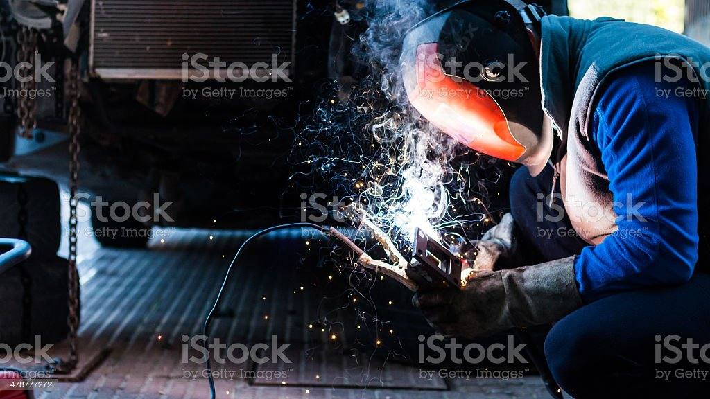 Mechanic welding stock photo