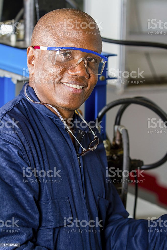 mechanic with glasses smiling royalty-free stock photo
