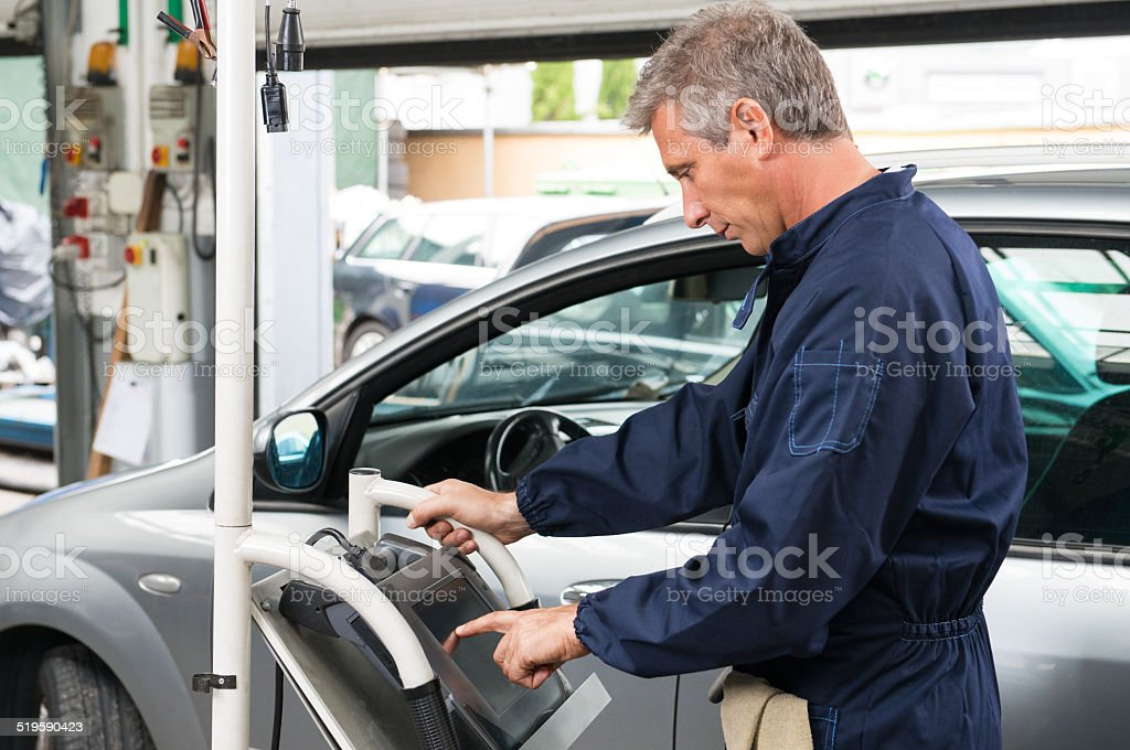 Mechanic Working At Control Unit stock photo
