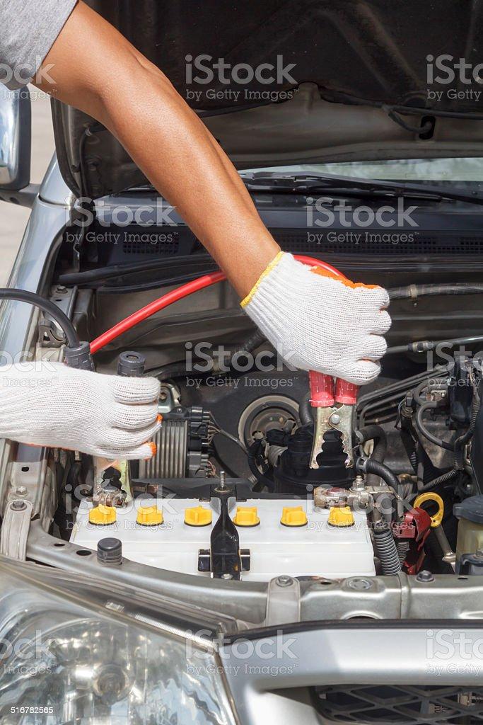 mechanic working in auto repair shop. stock photo