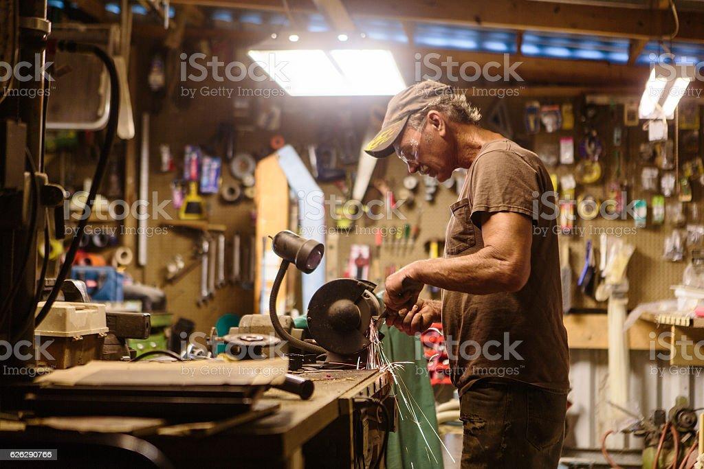 Mechanic working in garage shop stock photo