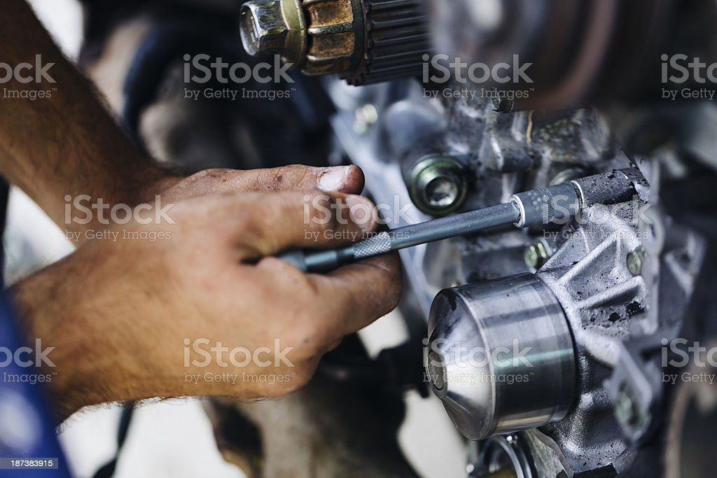 A mechanic working on a car engine royalty-free stock photo