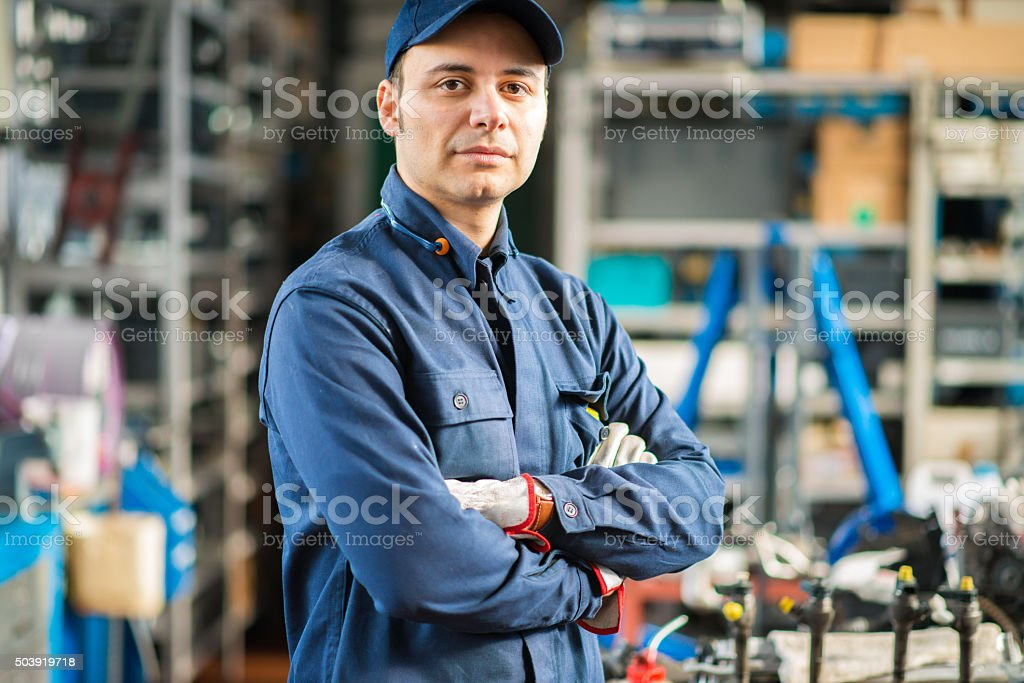 Mechanic working on a car engine stock photo