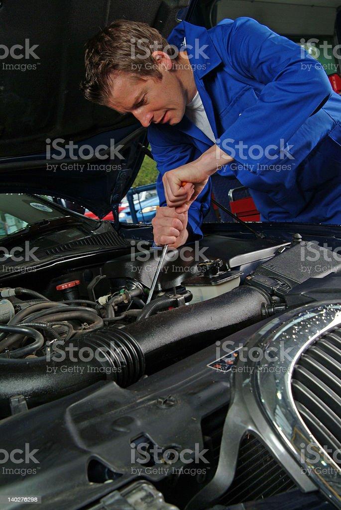 Mechanic working on a Jaguar engine royalty-free stock photo