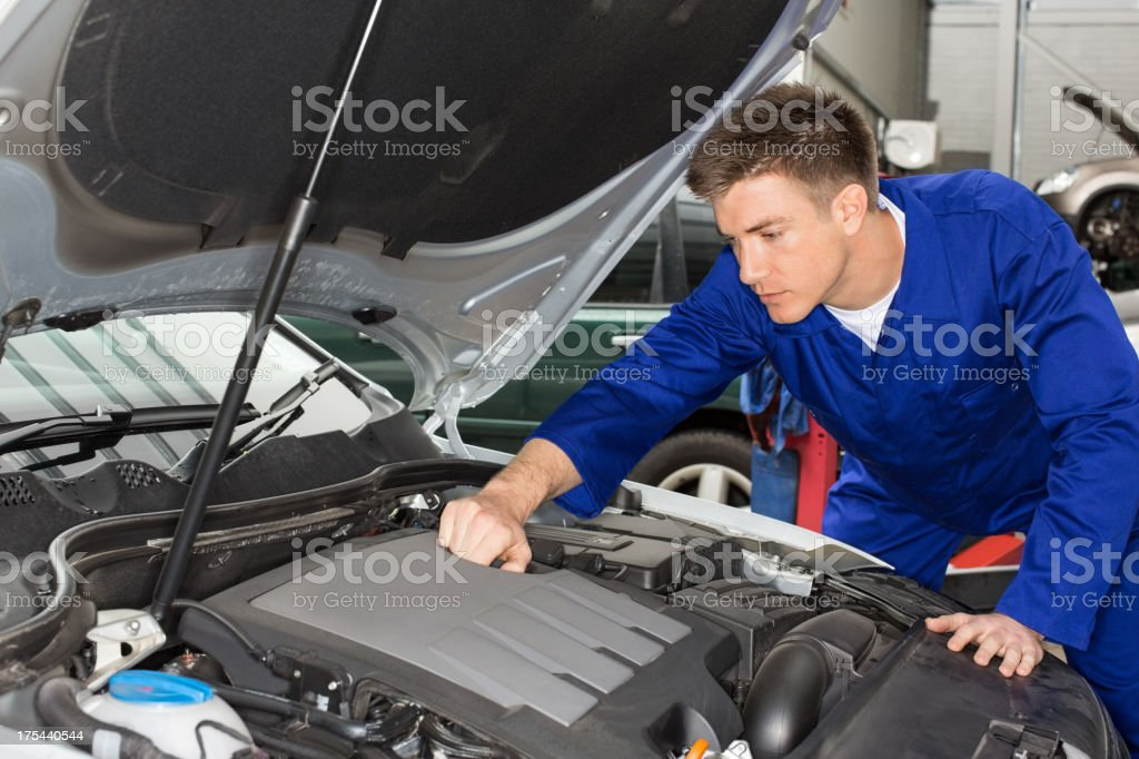 Mechanic Working On Car Engine royalty-free stock photo