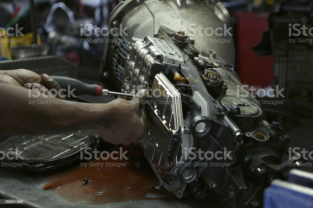 Mechanic Working on Car Transmission stock photo