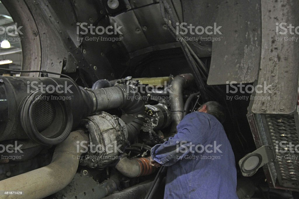 Mechanic working on engine, coe truck stock photo