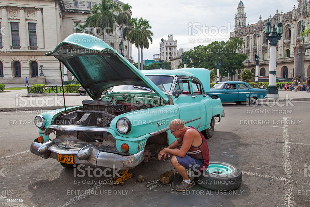 Mechanic working on the streets in Habana royalty-free stock photo