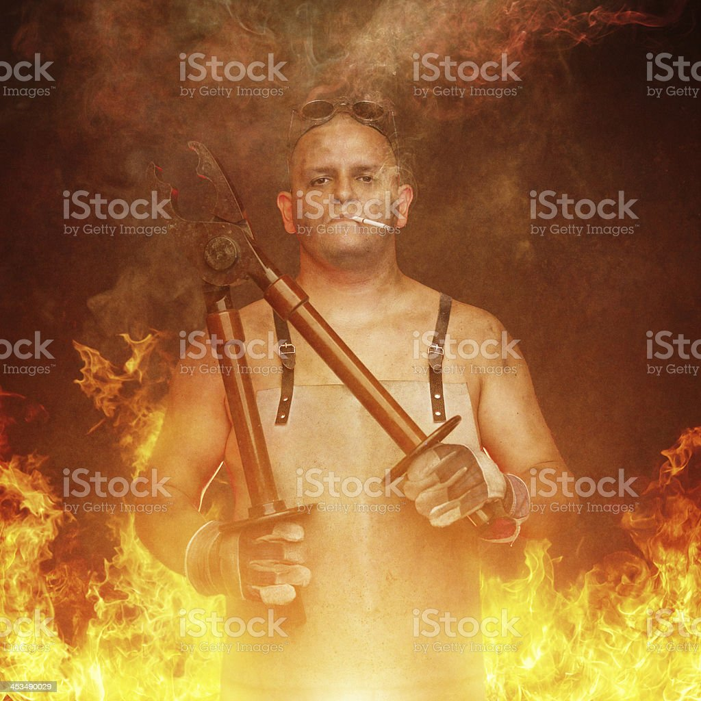 mechanic working with a huge plier royalty-free stock photo
