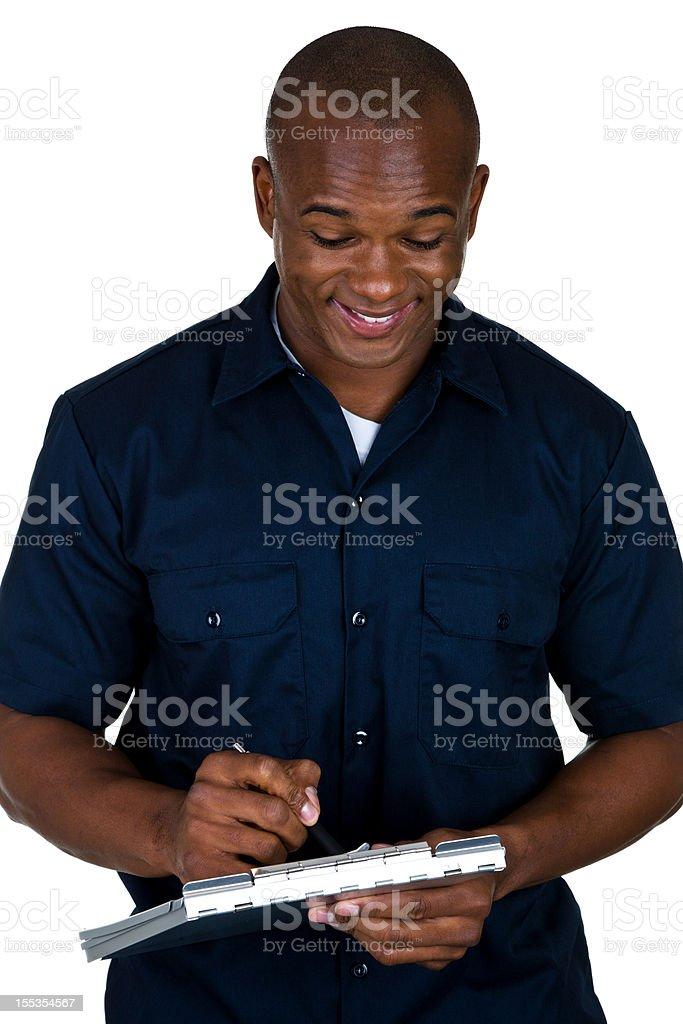 Mechanic writing an estimate royalty-free stock photo
