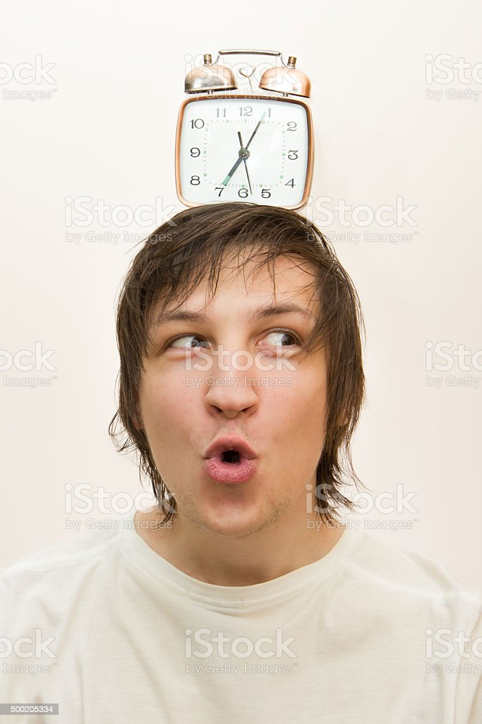 mechanical alarm clock  stand on head funny white man stock photo