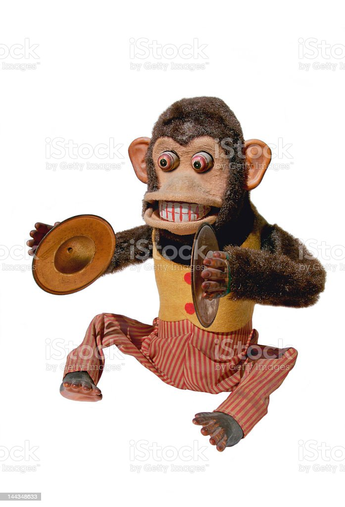 A mechanical chimp with cymbals on a white background stock photo