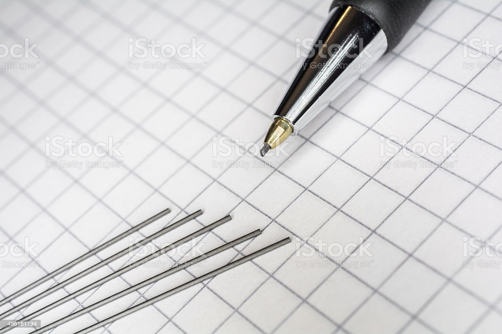 Mechanical Pencil With 5 Leads On Squared Paper 1 stock photo