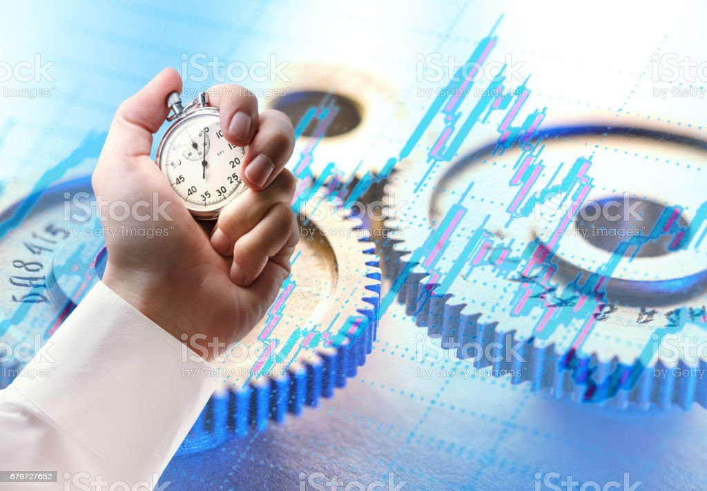 Mechanical ratchets and stopwatch in hand stock photo