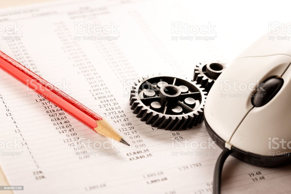 Mechanical ratchets, mouse, pencil and budget stock photo