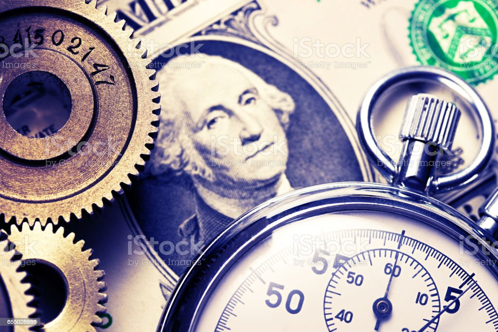 Mechanical ratchets, stopwatch and dollar stock photo