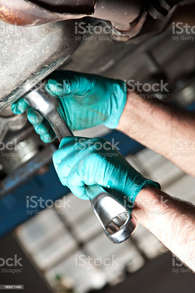 Mechanical repairs a car in the garage. stock photo