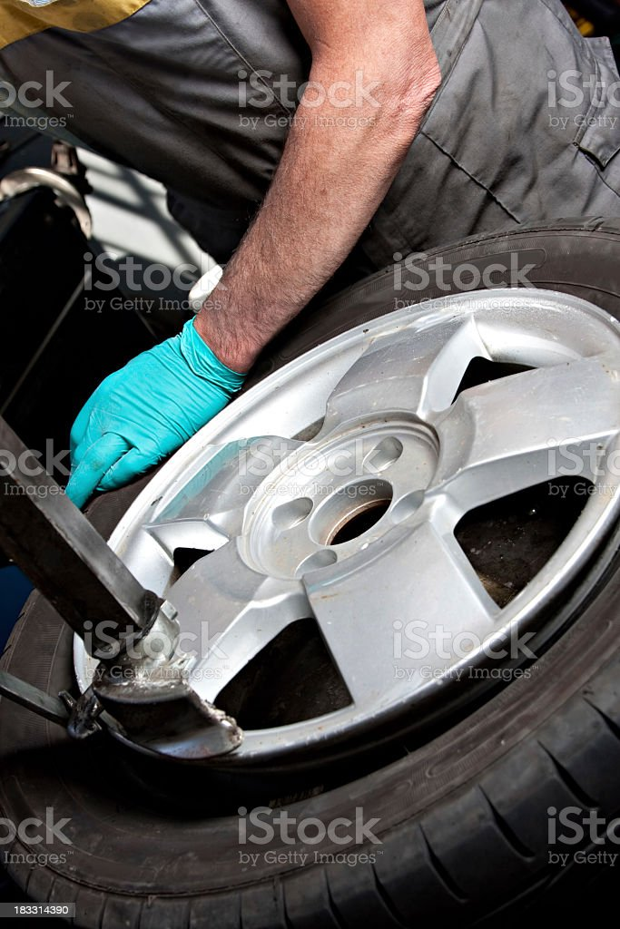 Mechanical repairs a tire. stock photo