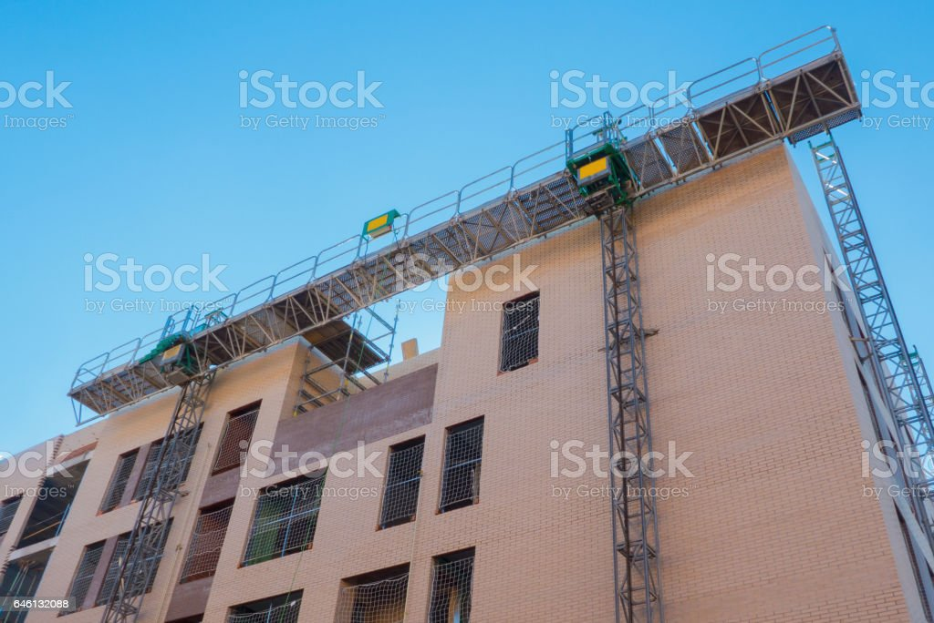 mechanical scaffolding in a building construction stock photo
