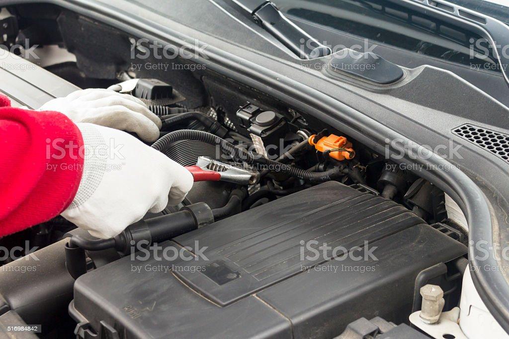 Mechanician performing maintenance on a car engine stock photo