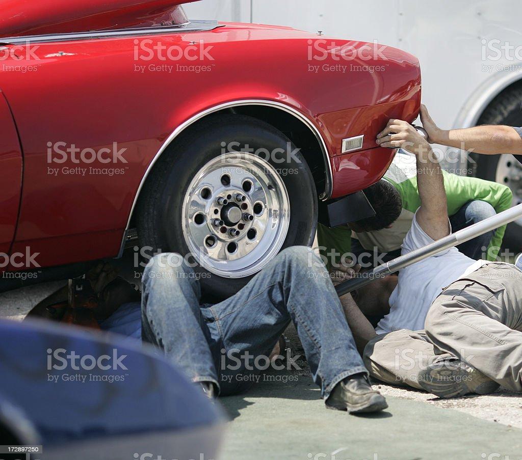 Mechanics fix a car stock photo