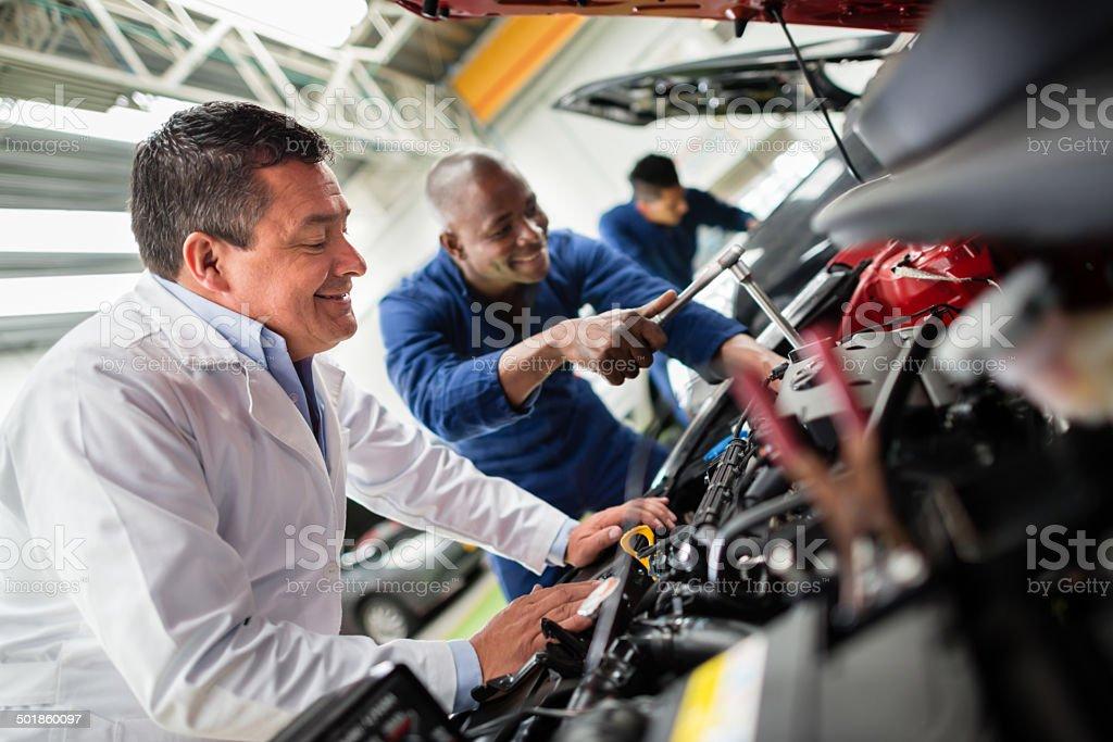 Mechanics fixing a car stock photo