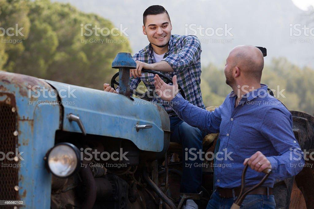 mechanics reparing old agrimotors at farm stock photo