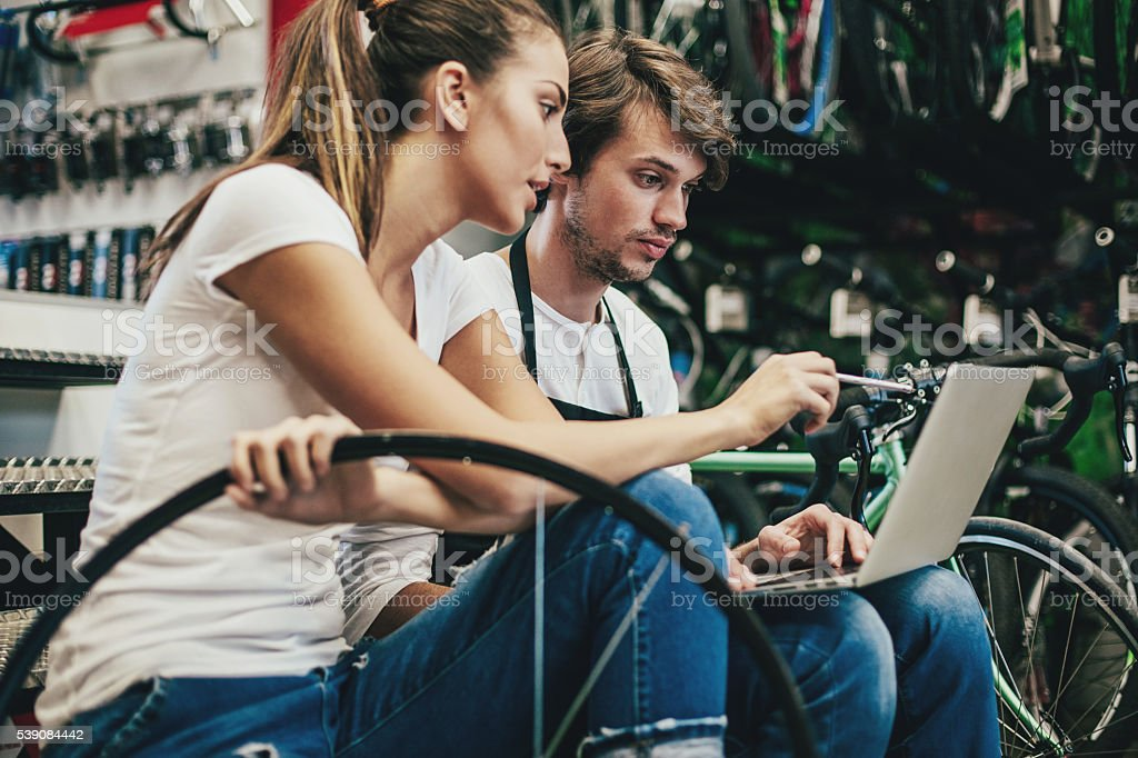 Mechanics with laptop and tools stock photo
