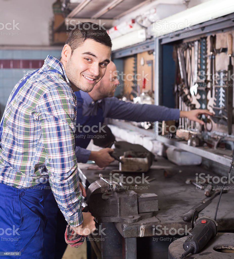 Mechanics working at workshop stock photo
