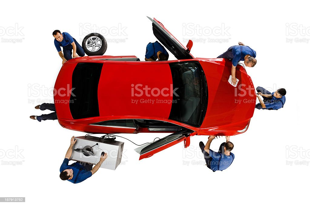 Mechanics working on a car royalty-free stock photo