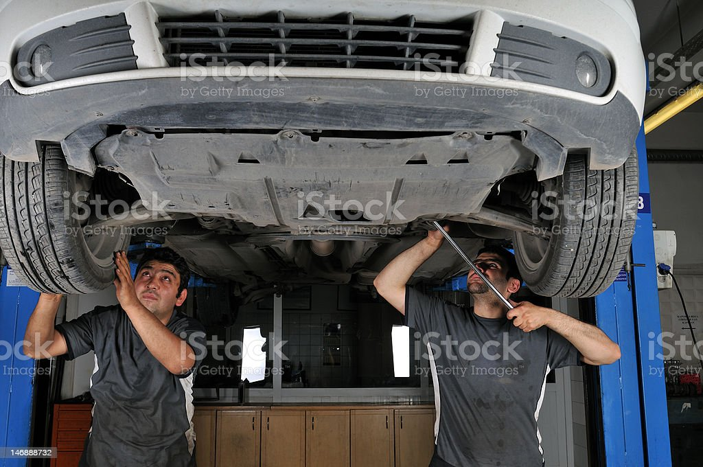 Mechanics working stock photo